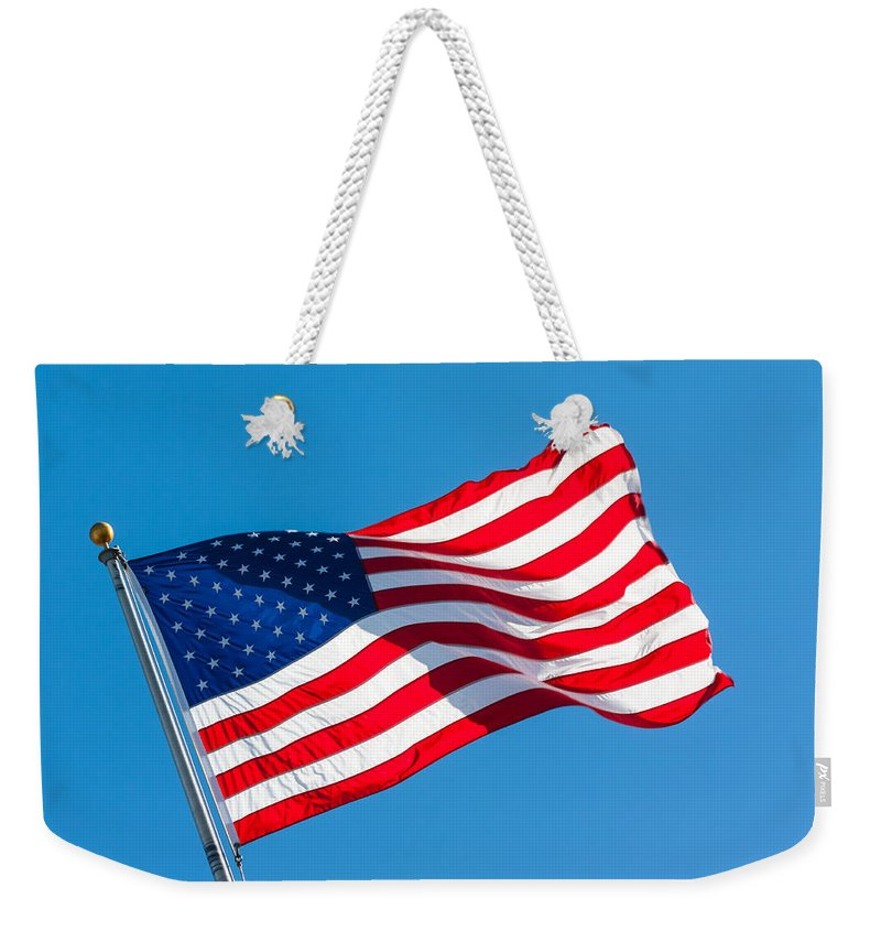 Us Flag Weekender Tote Bag featuring the photograph Stars And Stripes Waving by Ed Gleichman