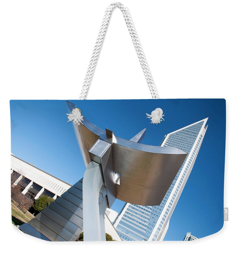 At Charlotte City Weekender Tote Bag featuring the photograph Statue At Charlotte City Street Entrance On North Tryon by Alex Grichenko