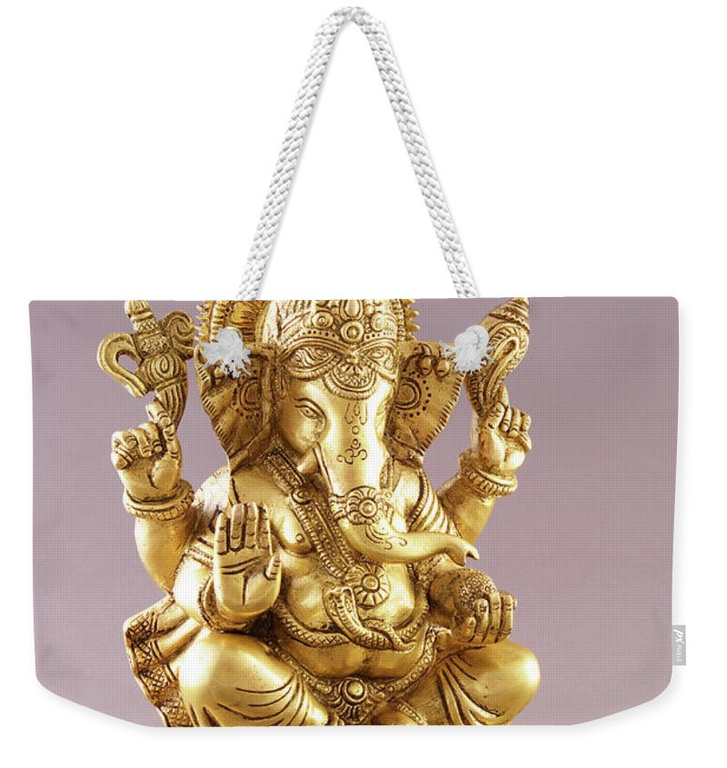 Spirituality Weekender Tote Bag featuring the photograph Statue Of Lord Ganesh by Visage