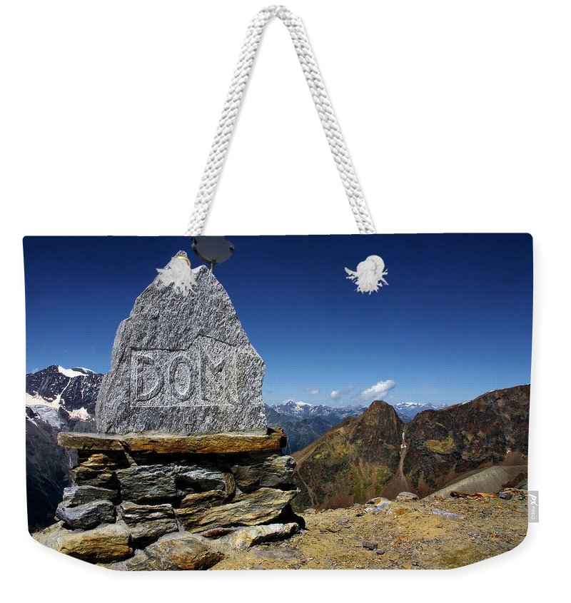 Mountains Weekender Tote Bag featuring the photograph Statue The Dom by Annie Snel