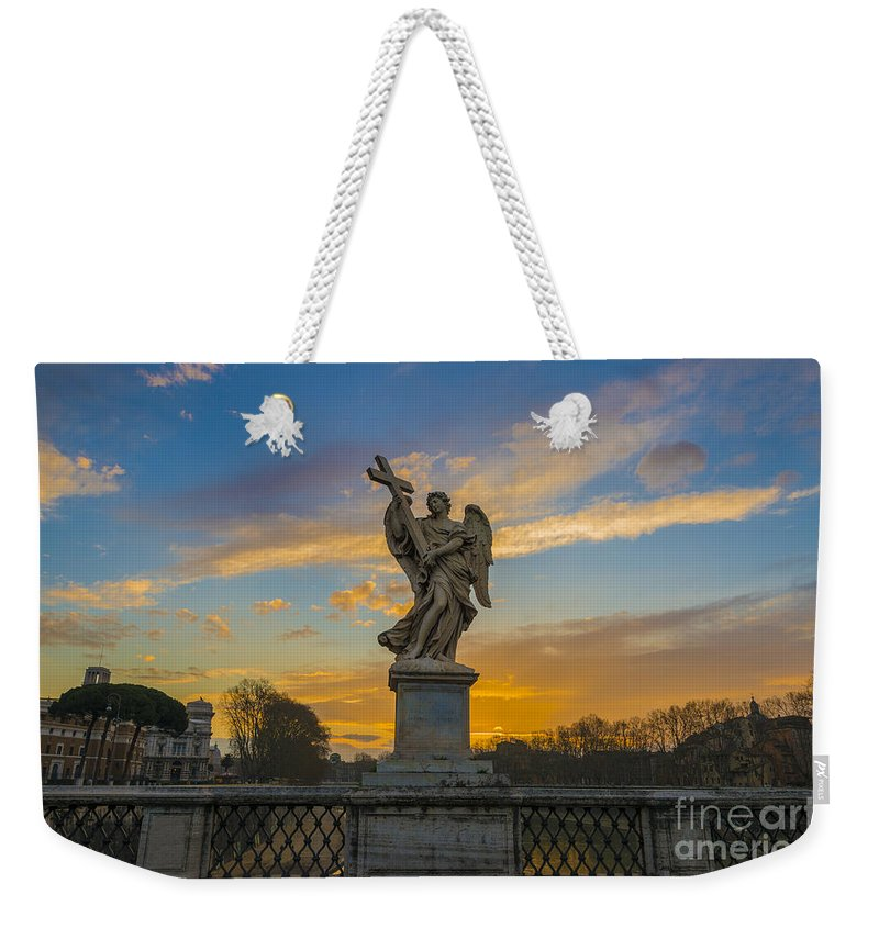 Statue Weekender Tote Bag featuring the photograph Statue With Cross by Mats Silvan