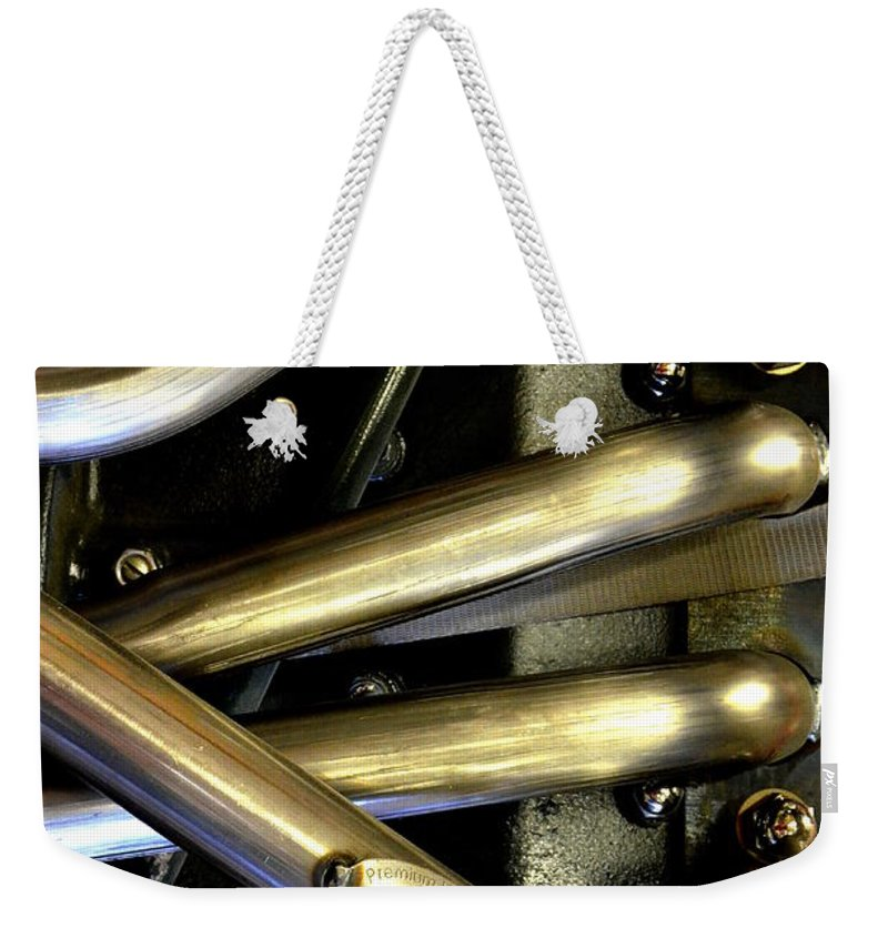 Abstract Weekender Tote Bag featuring the photograph Steely Arms by Lauren Leigh Hunter Fine Art Photography