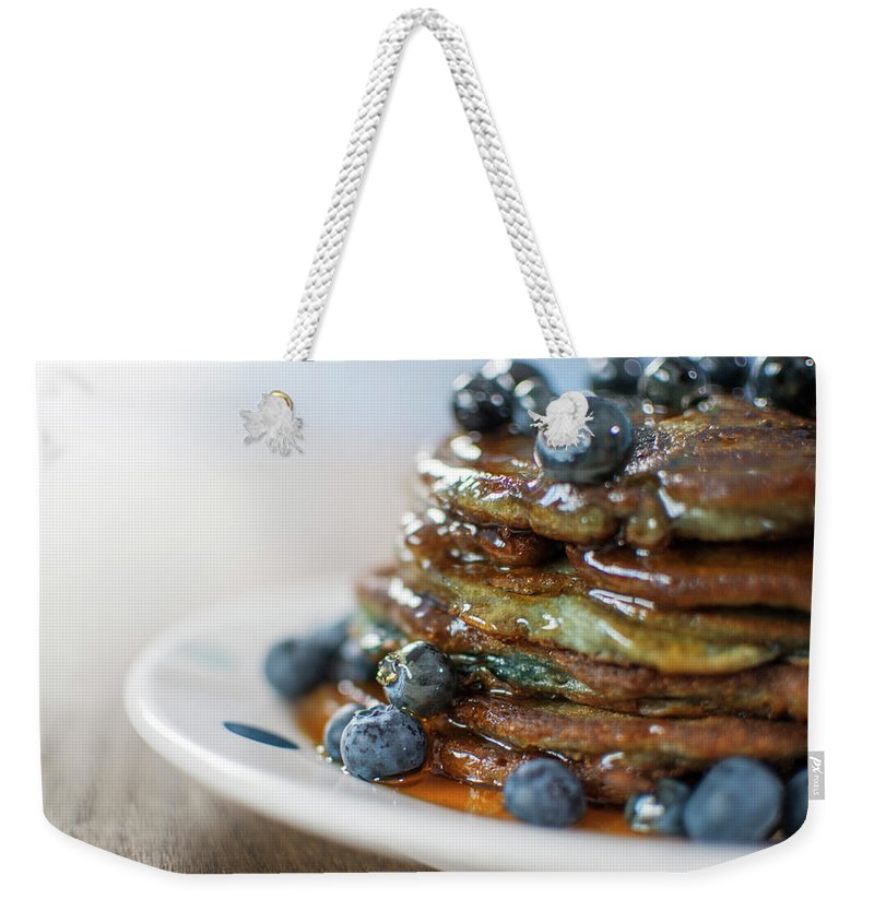 Unhealthy Eating Weekender Tote Bag featuring the photograph Still Life Of Blueberry Pancakes With by Matt Walford