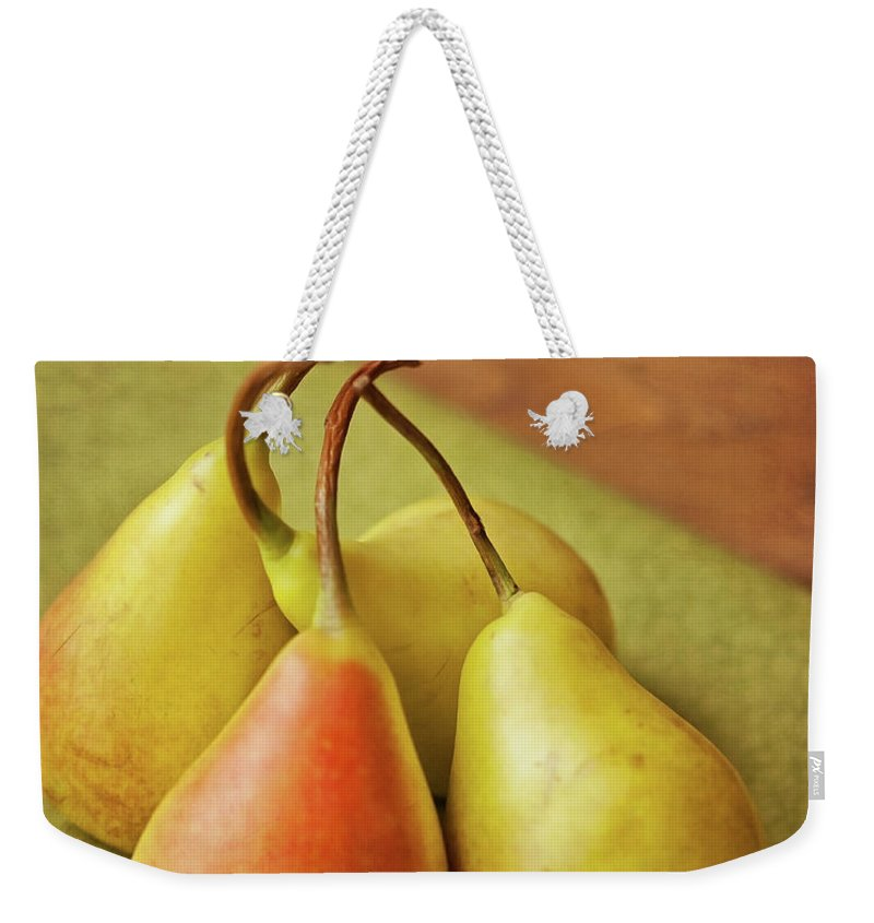 Wood Weekender Tote Bag featuring the photograph Still Life Of Pears by Carol Yepes