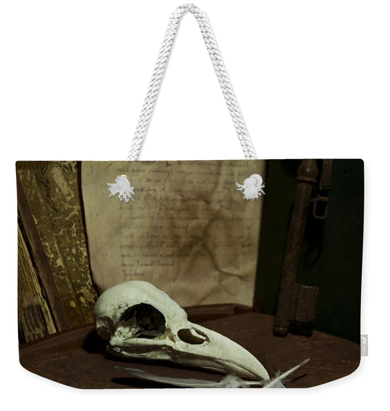 Still Life Weekender Tote Bag featuring the photograph Still Life With Old Books Rusty Key Bird Skull And Feathers by Jaroslaw Blaminsky