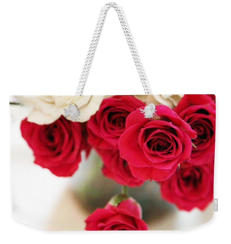 Roses Weekender Tote Bag featuring the photograph Still Moments by Amanda Barcon