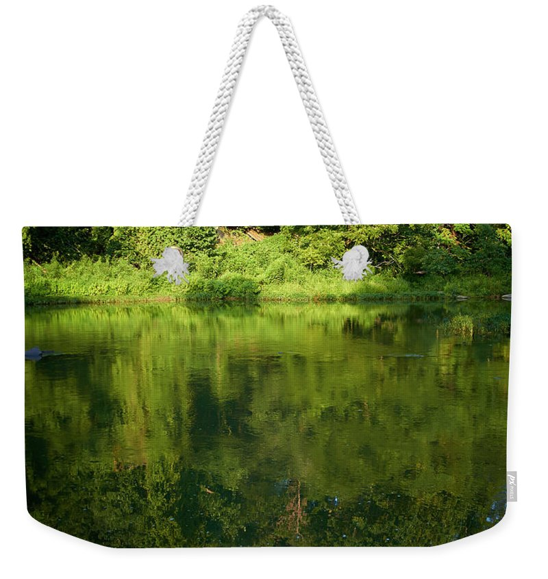 Tranquility Weekender Tote Bag featuring the photograph Still Water On The Potomac River by Cameron Davidson