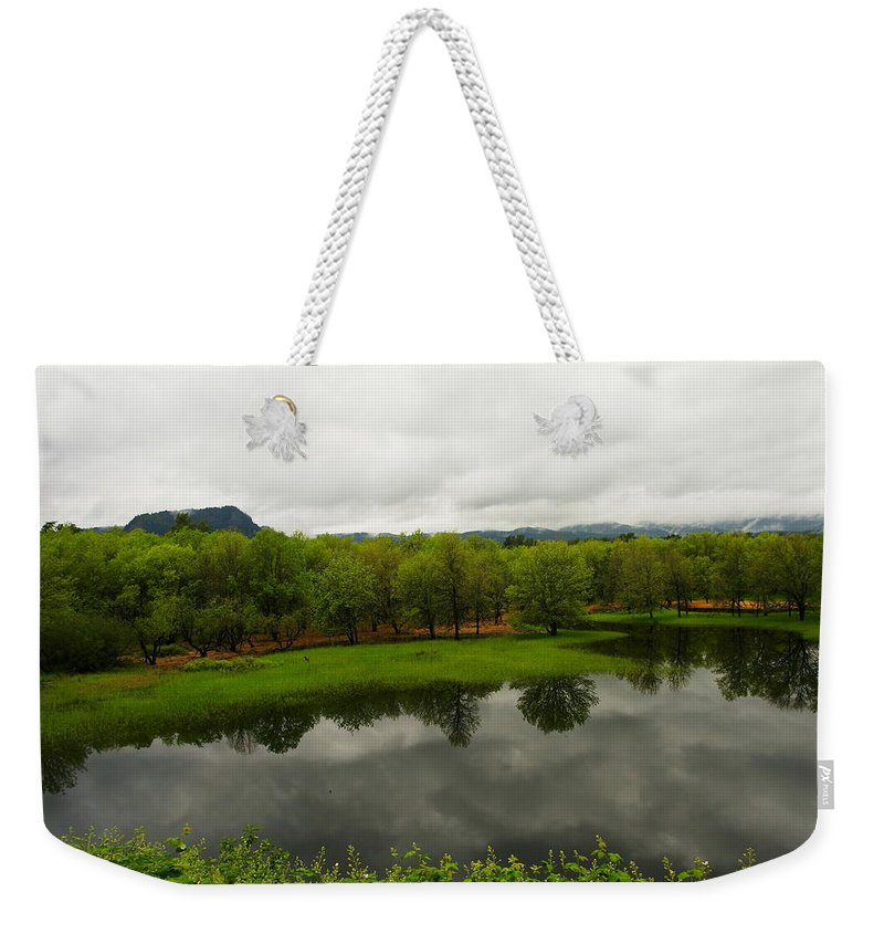 Water Weekender Tote Bag featuring the photograph Still Water Reflecting by Jeff Swan