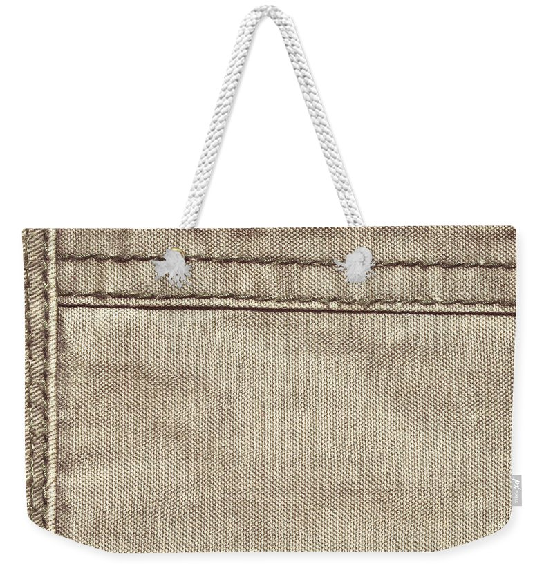Backdrop Weekender Tote Bag featuring the photograph Stitched Seams by Tom Gowanlock