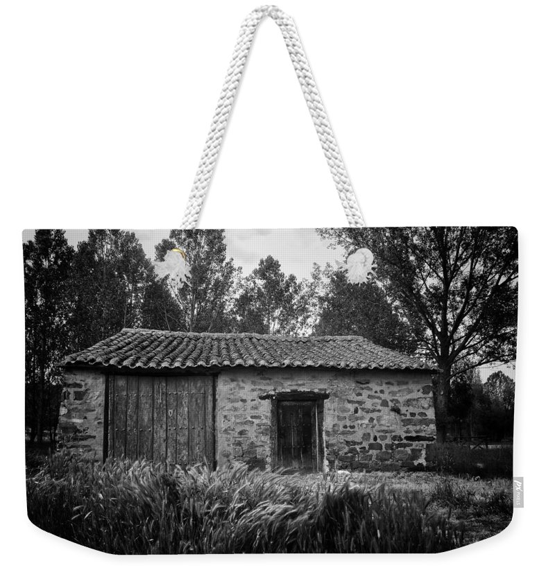 Stone Weekender Tote Bag featuring the photograph Stone Building by Tom Bell