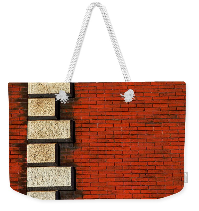 Stone Weekender Tote Bag featuring the photograph Stone On Brick by Karol Livote