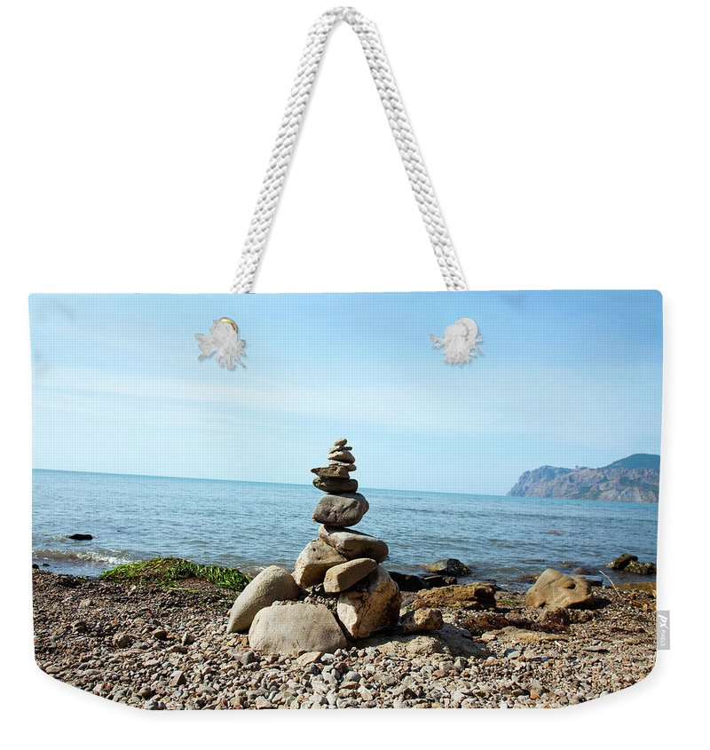 Heap Weekender Tote Bag featuring the photograph Stone Tower On The Beach by Mashabuba