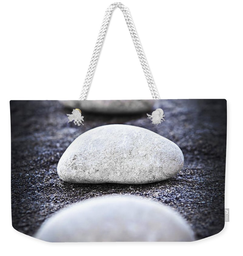 Stone Weekender Tote Bag featuring the photograph Stones by Elena Elisseeva