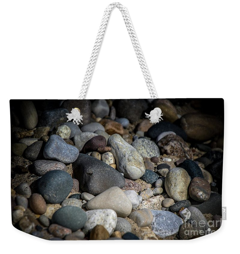 Stones Weekender Tote Bag featuring the photograph Stones On Beach by Ronald Grogan