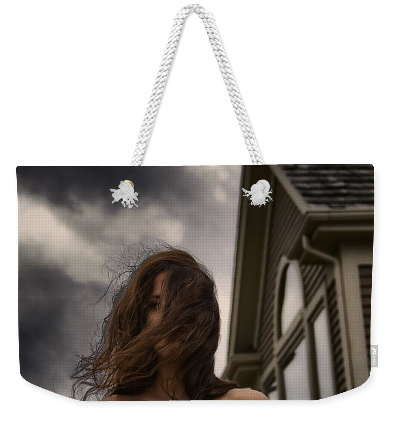 Caucasian; Woman; Lady; Female; Outside; Outdoors; Storm; Stormy; Clouds; Dark; Ominous; Wind; Windy; House; Home; Horror; Scary; Mysterious; Mystery; Foreboding; Hair; Long Hair; Brunette; Dress; Gold; Strapless; Windows; Domineering; Haunted; Scared; Terror Weekender Tote Bag featuring the photograph Storm by Margie Hurwich