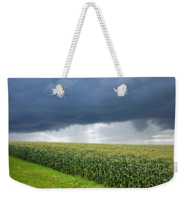 Corn Weekender Tote Bag featuring the photograph Storm Over Cornfield In Southern Germany by Ian Middleton