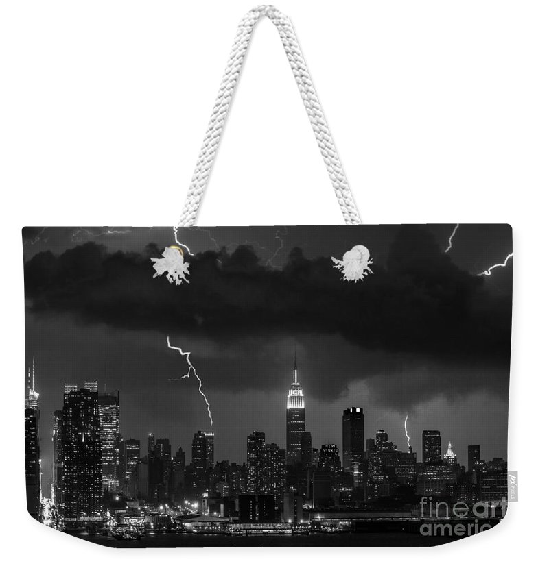 New York City Weekender Tote Bag featuring the photograph Storm Over Nyc by Jerry Fornarotto