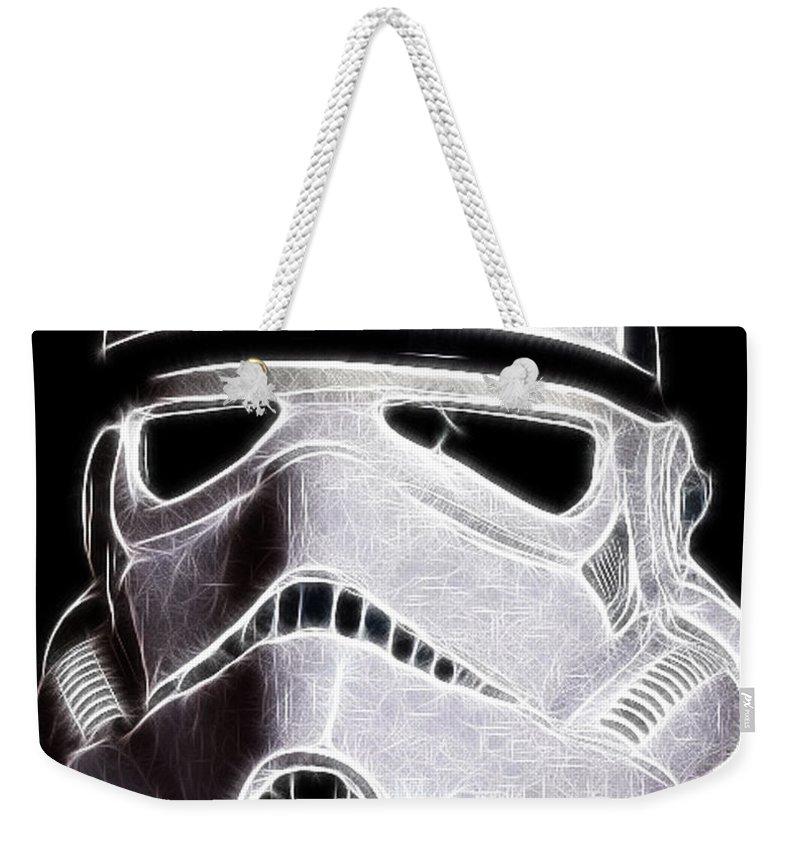 Storm Trooper Weekender Tote Bag featuring the photograph Storm Trooper Helmet by Paul Ward