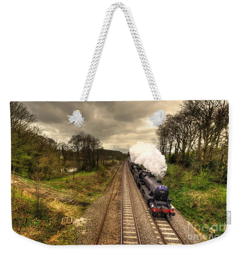 Whiteball Weekender Tote Bag featuring the photograph Stormin The Bank by Rob Hawkins