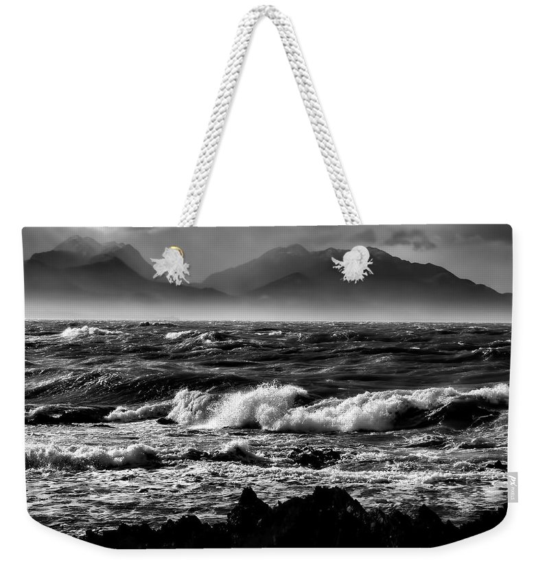 Rough Sea Weekender Tote Bag featuring the photograph Stormy Coast New Zealand In Black And White by Amanda Stadther