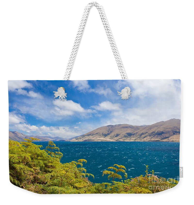 Beautiful Weekender Tote Bag featuring the photograph Stormy Surface Of Lake Wanaka In Central Otago On South Island Of New Zealand by Stephan Pietzko