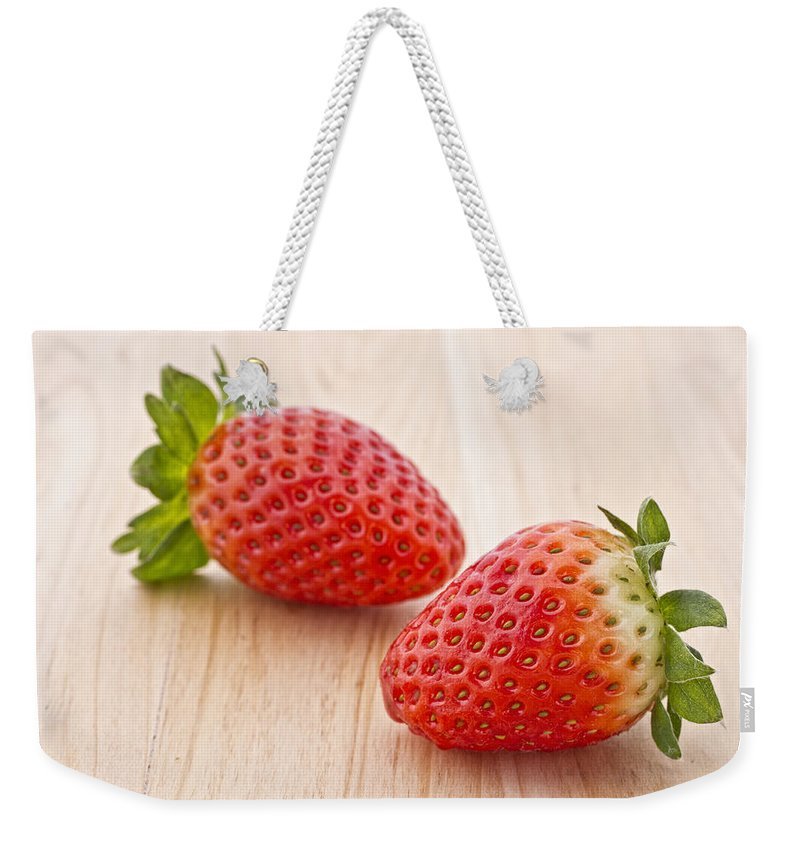 Juicy Weekender Tote Bag featuring the photograph Strawberry by Paulo Goncalves