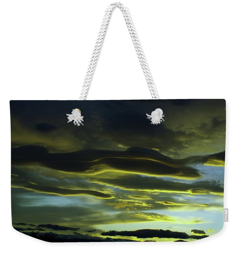 Clouds Weekender Tote Bag featuring the photograph Streaming Clouds by Jeff Swan