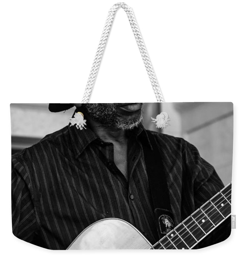 Black And White Weekender Tote Bag featuring the photograph Street Musician Black And White by Jon Cody