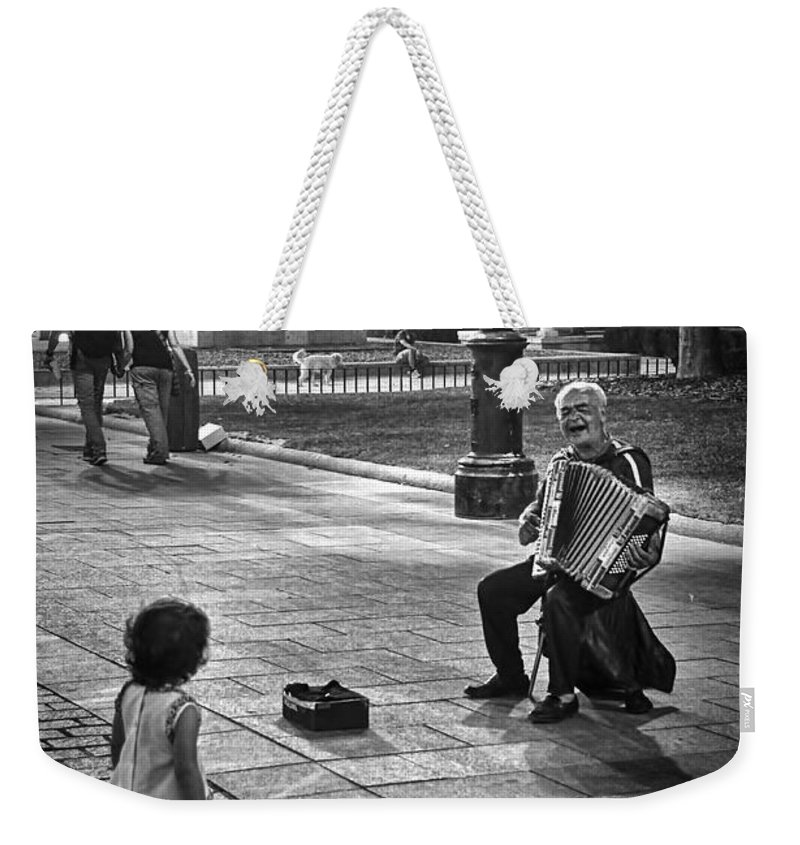 Accordion Weekender Tote Bag featuring the photograph Street Performance by Tom Bell
