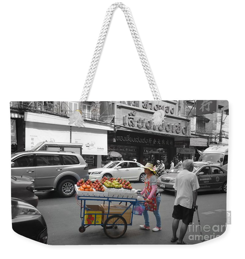 Michelle Meenawong Weekender Tote Bag featuring the photograph Street Seller by Michelle Meenawong