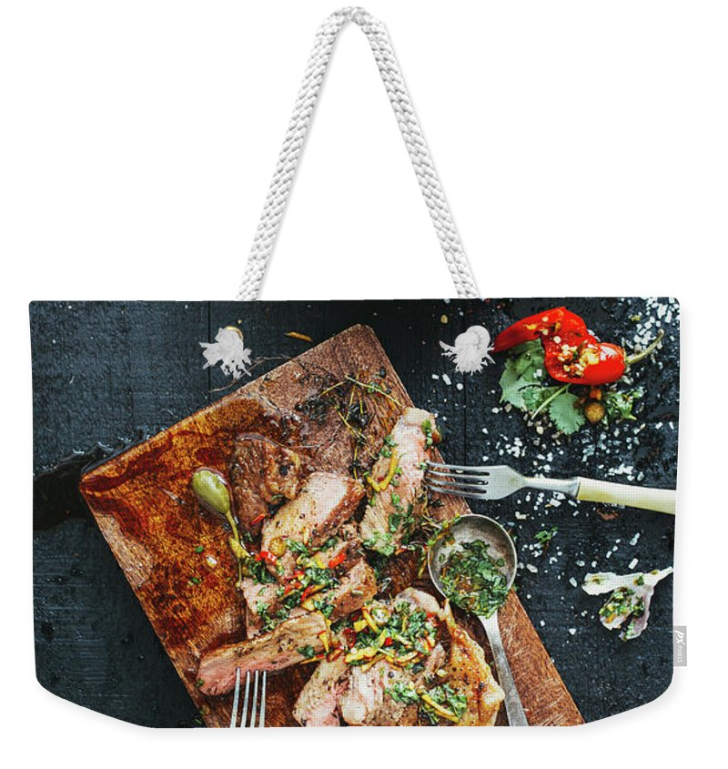 Cutting Board Weekender Tote Bag featuring the photograph Strip Steak by Eugene Mymrin