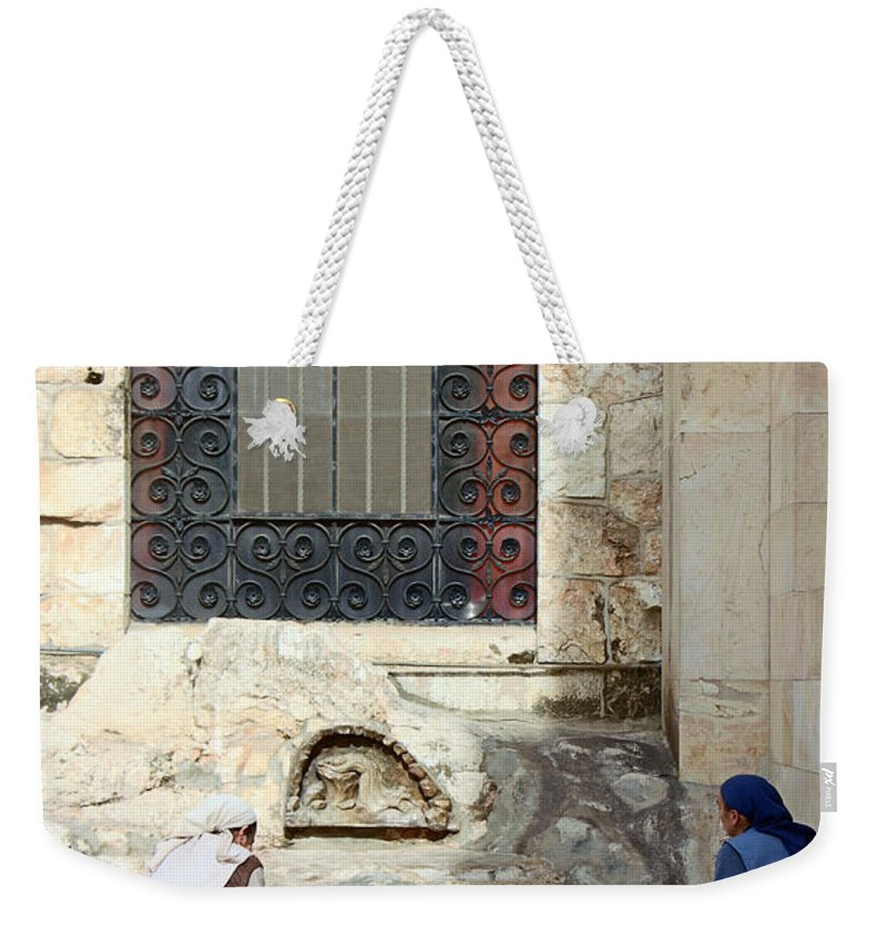 Submission Weekender Tote Bag featuring the photograph Submission by Munir Alawi