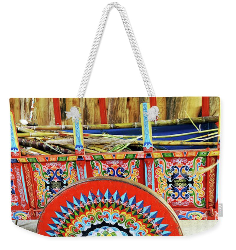Photography Weekender Tote Bag featuring the photograph Sugar Canes In La Carreta The Oxcart by Panoramic Images