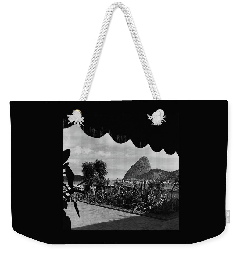 Exterior Weekender Tote Bag featuring the photograph Sugarloaf Mountain Seen From The Patio At Carlos by Luis Lemus