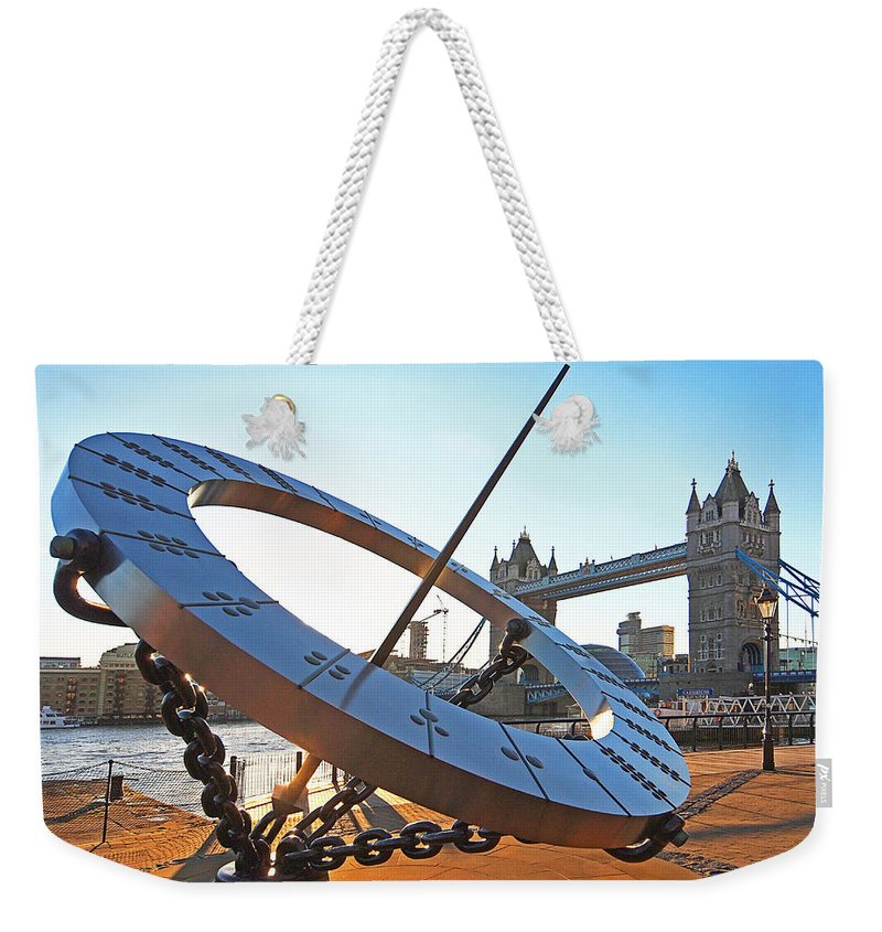 London Weekender Tote Bag featuring the photograph Sun Dial And Tower Bridge London by Gill Billington
