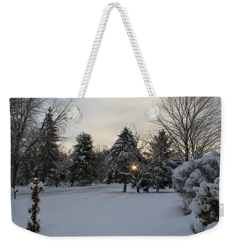 Sun Rising Weekender Tote Bag featuring the photograph Sun Peeking Through by Catie Canetti