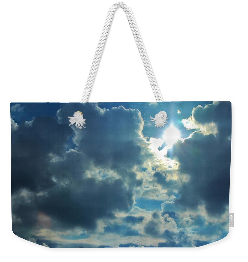 Cloud Weekender Tote Bag featuring the photograph Sun Peeping Out by Cynthia Guinn