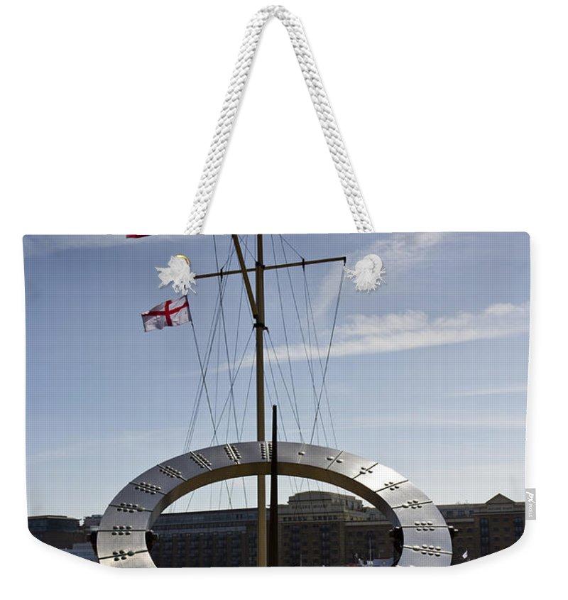 Sun Weekender Tote Bag featuring the photograph Sundial St Katherines Dock by David Pyatt
