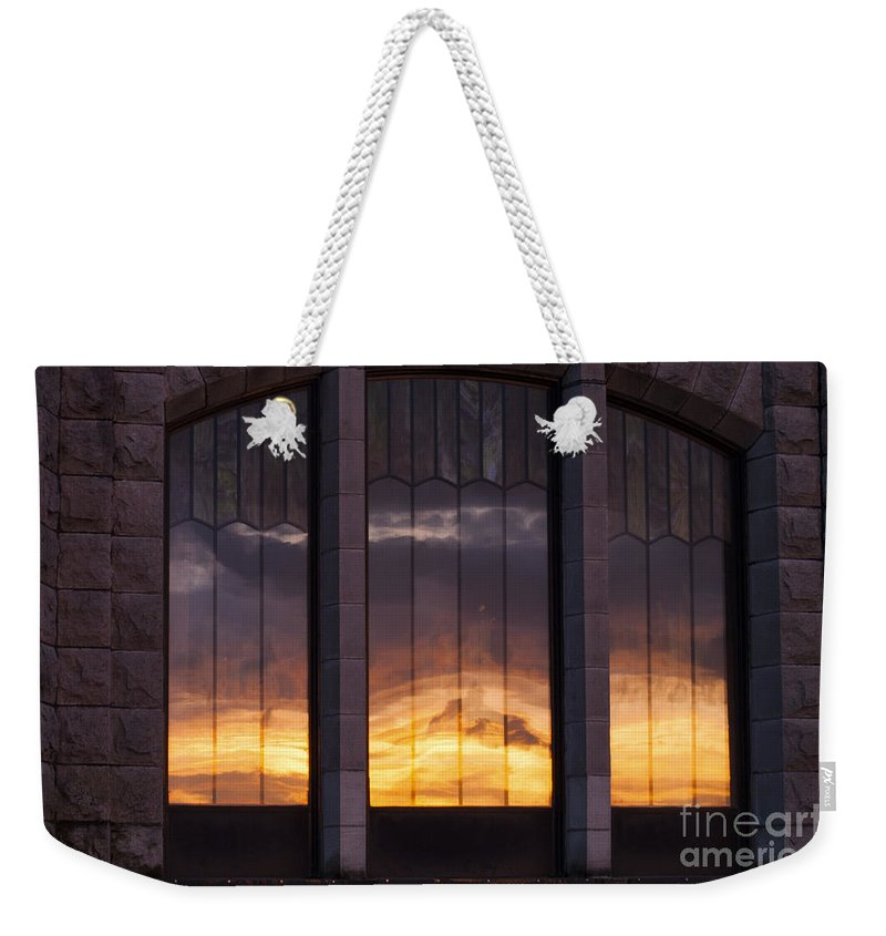 Columbia River Gorge Oregon Sunset Sunsets Windows Window Reflection Building Buildings Structure Structures Reflections Stone Stones Vertical Line Horizontal Lines Late Evening Cloud Clouds Architecture Weekender Tote Bag featuring the photograph Sundown by Bob Phillips