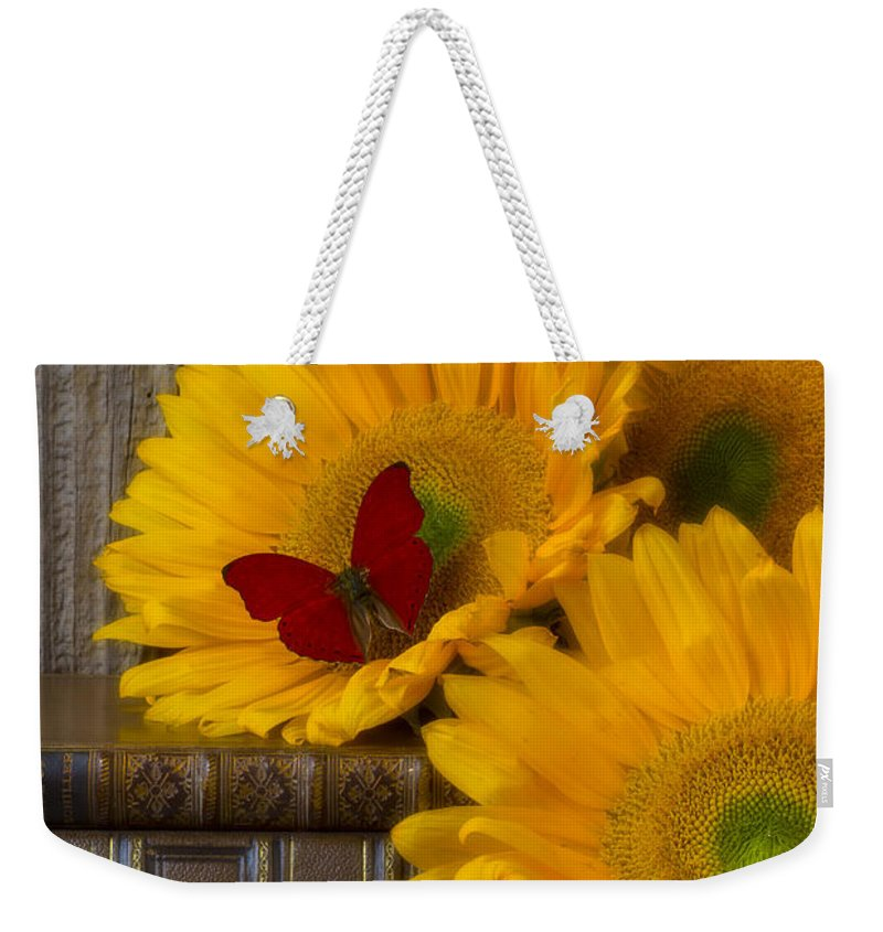Sunflowers Weekender Tote Bag featuring the photograph Sunflowers And Old Books by Garry Gay