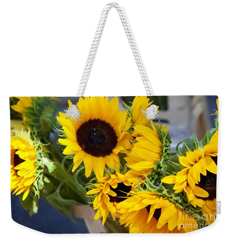 Sunflower Weekender Tote Bag featuring the photograph Sunflowers At Market by Brian Jannsen