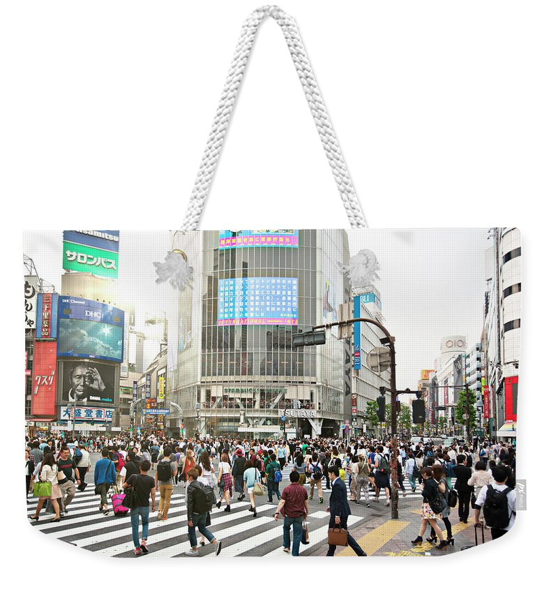 Crowd Weekender Tote Bag featuring the photograph Sunny Day In Shibuya by Xavierarnau