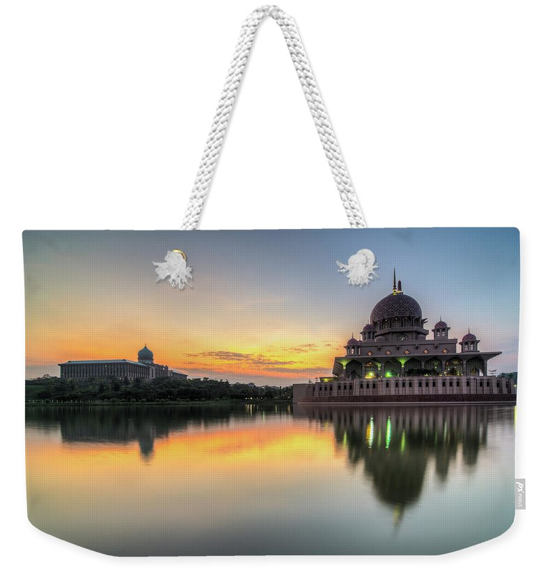 Tranquility Weekender Tote Bag featuring the photograph Sunrise   Masjid Putra, Putrajaya   Hdr by Mohamad Zaidi Photography