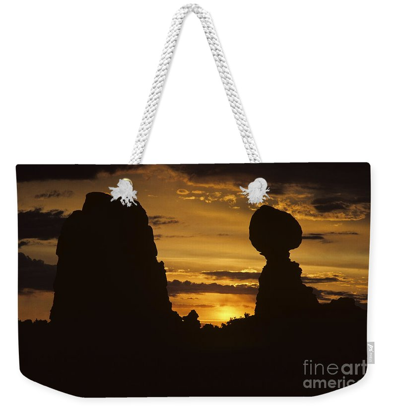 Landscape Weekender Tote Bag featuring the photograph Sunrise Arches National Park With Balanced Rock Silhouetted Agai by Jim Corwin