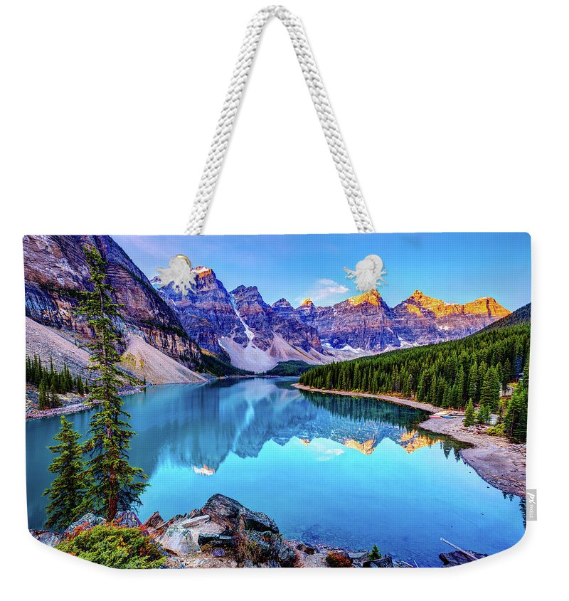 Tranquility Weekender Tote Bag featuring the photograph Sunrise At Moraine Lake by Wan Ru Chen