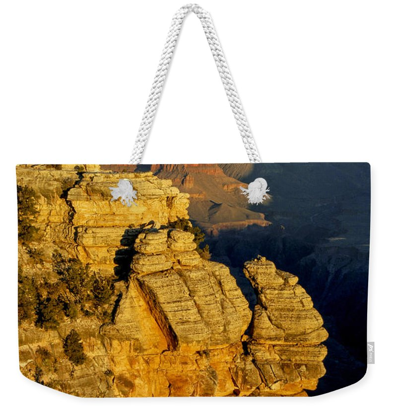 Grand Canyon National Park Arizona Parks Mather Point South Rim Canyons Rock Formations Rock Formation Sunrise Sunrises Landscape Landscapes Landmark Landmarks Weekender Tote Bag featuring the photograph Sunrise In The Canyon by Bob Phillips