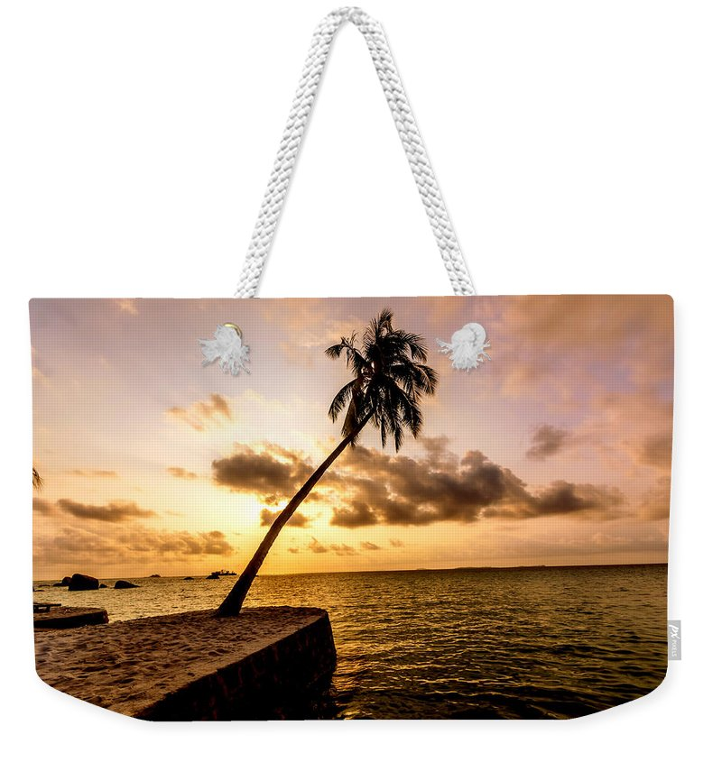 Seal Rock Weekender Tote Bag featuring the photograph Sunrise by Jijo George