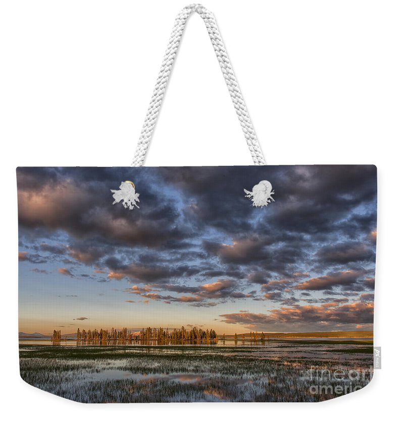 Sunrise;yellowstone;lake;waterscape;national;park;clouds;morning;dawn;reflections;reflection;island;trees;iconic;travel;tourism;popular; Weekender Tote Bag featuring the photograph Sunrise On Yellowstone Lake by Sandra Bronstein