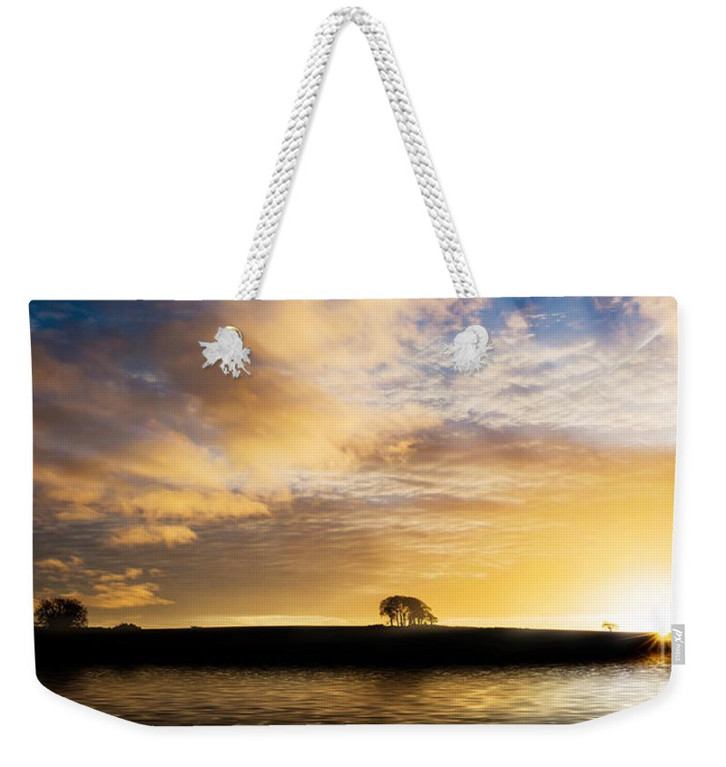 Sunrise Weekender Tote Bag featuring the photograph Sunrise Over Silouette Landscape by Simon Bratt Photography LRPS