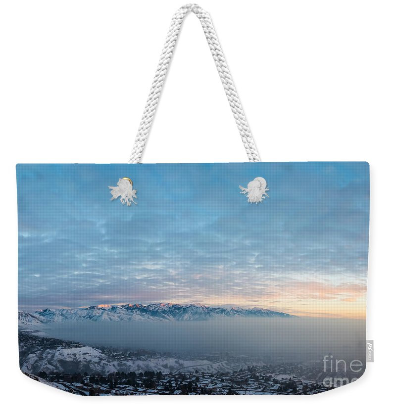 Salt Lake City Weekender Tote Bag featuring the photograph Sunset Above The Smog by Michael Ver Sprill